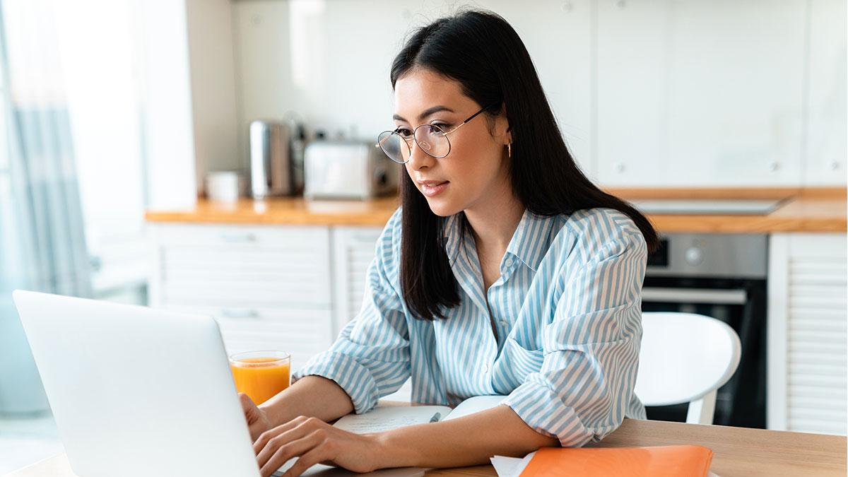 Property manager searching for what is a smart apartment on laptop computer